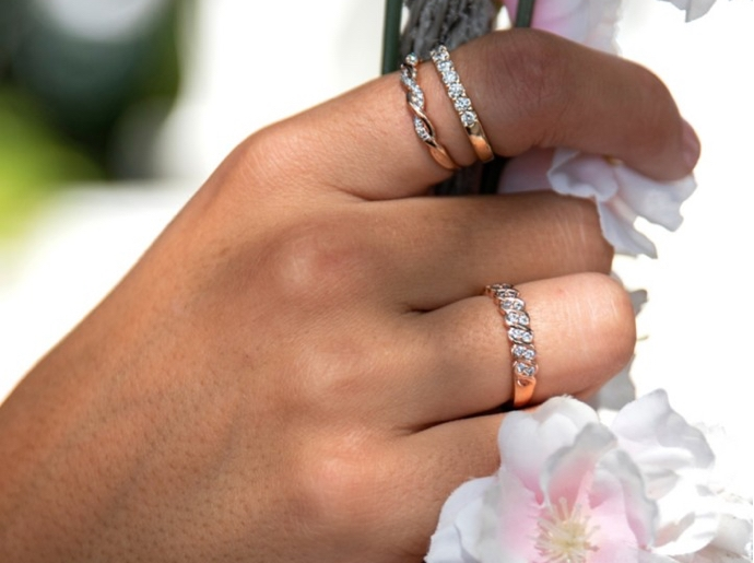 Hand featuring stacked diamond bands