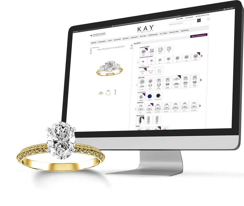 A KAY yellow gold diamond ring next to a desktop screen featuring the KAY ring customizer