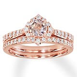 A 14k rose gold band with diamonds and a round-cut morganite center stone