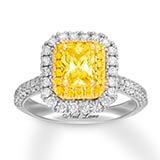 A Neil Lane brand 14k white gold band with diamonds and a yellow diamond center stone set in 14k yellow gold