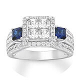 A wide-set white gold band with diamond and sapphire stones and a princess-cut center diamond