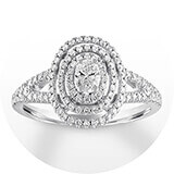 A white gold and diamond band with a diamond halo and oval-cut center stone