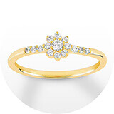A gold and diamond band with a round diamond and floral-inspired design center