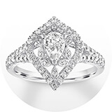A white gold and diamond band with a vintage design around a pear-shaped center