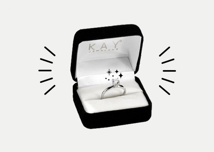 A KAY diamond engagement ring in its box