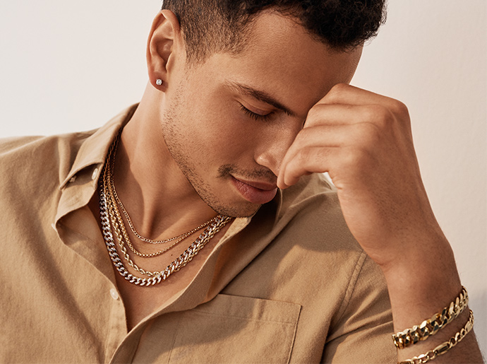 Man wearing layered gold chains