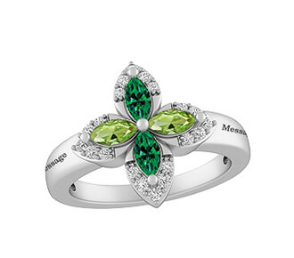A KAY personalized silver ring with peridot and emerald gemstones in a cross-shaped pattern
