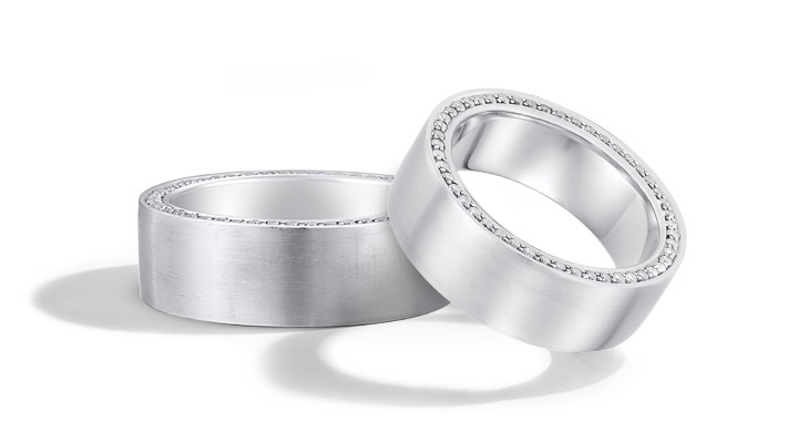 Two custom made men's wedding bands crafted by the expert jewelers at KAY